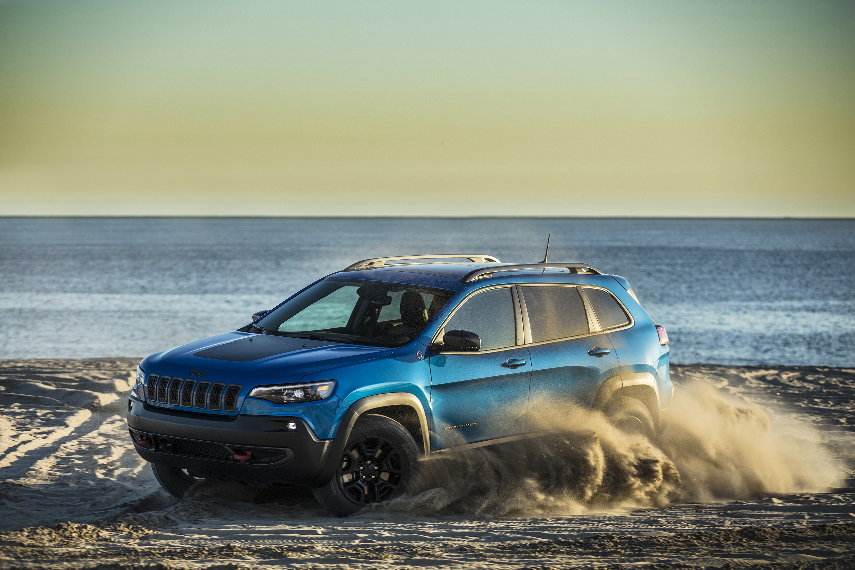 blue jeep cherokee on beach wallpaper 65160