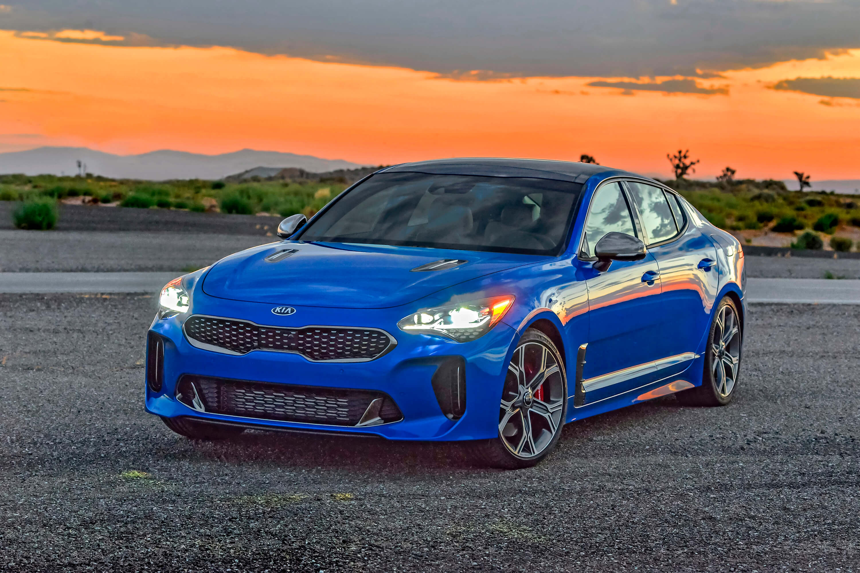 blue kia stinger background wallpaper 70357